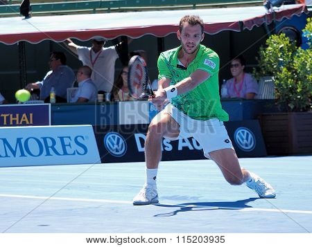 Paul-Henri Mathieu of France plays a backhand