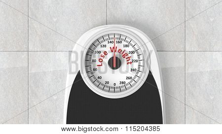 Bathroom scale with Lose Weight message on dial, on bathroom floor