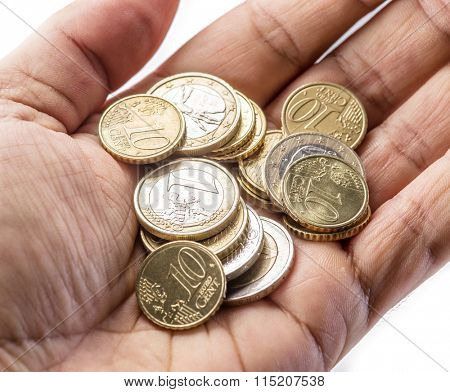 Euro coins on the man's palm on white background.