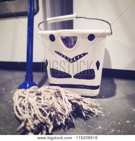 BLOOMFIELD NJ - JAN 8 2016: Filtered image of a Star Wars concept showing a Stormtrooper helmet being used as a moping bucket. Helmets are known as buckets among collectors and fans