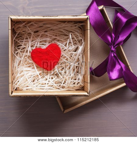 Celebratory Box With A Red Woolen Heart As A Gift