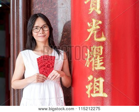 Asian Lady Holding Red Envelope Or Ang-pow ,pocket Money Gift.