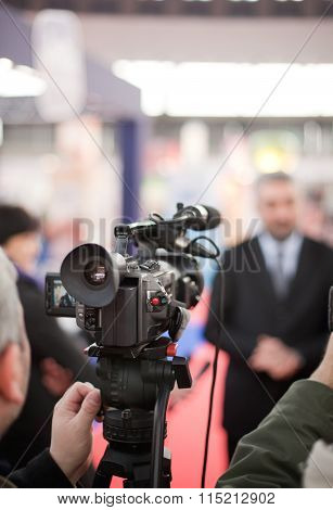 Filming media interview with a video camera