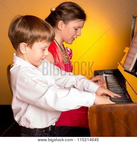Brother And Sister Playing Piano. Piano Player.