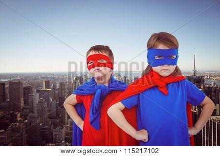 Masked kids pretending to be superheroes against new york skyline