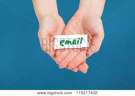 Hands presenting against paper email