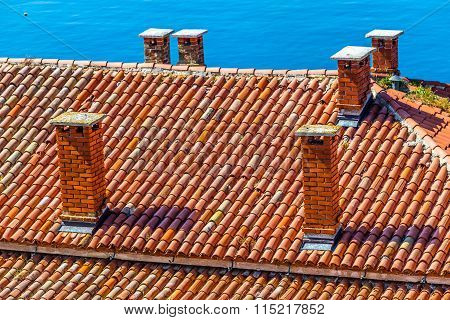Roof Made Of Red Tiles And Chimneys-rovinj,croatia