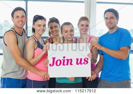 The word join us and portrait of a group of fitness class holding blank paper against modern blue and white room