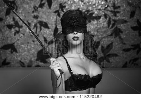 Sexy Woman In Lace Eye Cover Holding Whip Bdsm