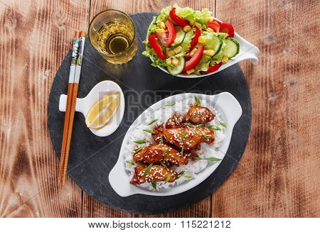 Teriyaki chicken with rice and salad japanese cuisine