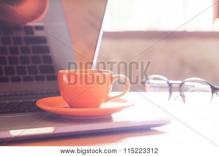Coffee Cup With Keyboard On Wooden Table