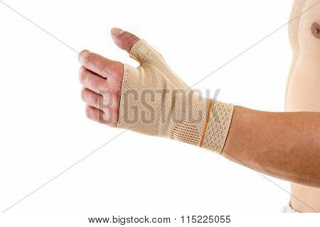 Man Wearing Flexible Wrist Brace In Studio