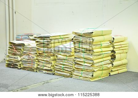Stack Of Tied Old Files Yellowing On Office Floor