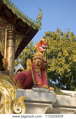 The sculpture red dragon in the temple, Thailand