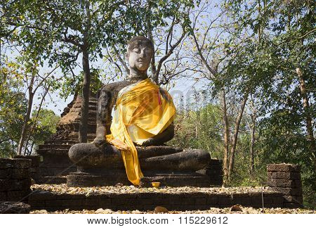 Ancient sculpture of the Buddha in ruins of Wat Khao. Si Satchanalai, Thailand