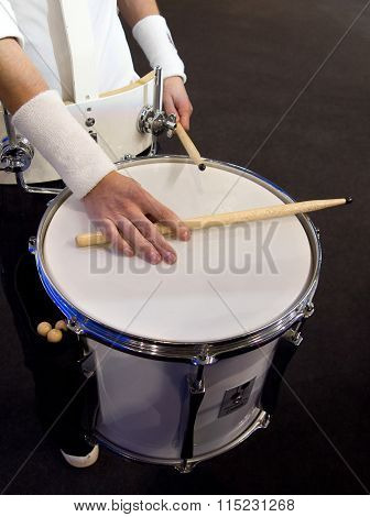 Hand drummer with drum sticks lying on the drum