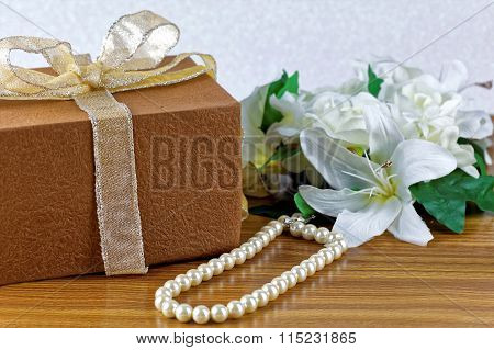 Large white flower, brown wrapped gift