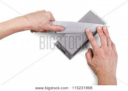 Knife Hand Sharpening Technique - Isolated On White With Clipping Path