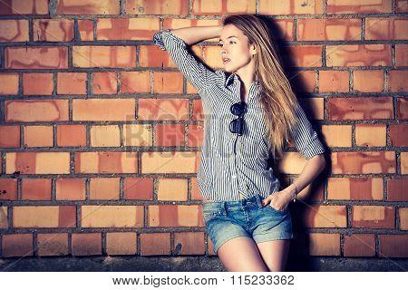 Street Style Fashion Girl at the Brick Wall