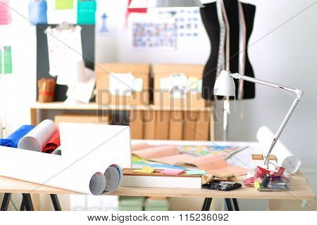 Designer work place with sew manikins, in office