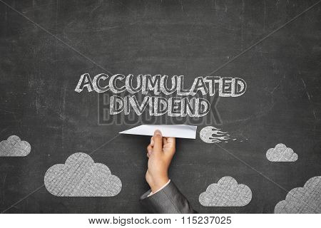 Accumulated dividend concept on blackboard with paper plane