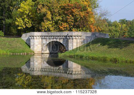 The Karpin bridge golden autumn. Gatchina Palace park. Russia