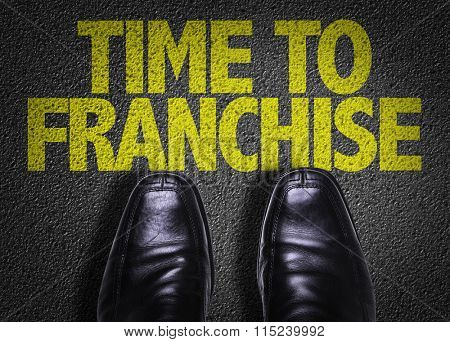 Top View of Business Shoes on the floor with the text: Time To Franchise