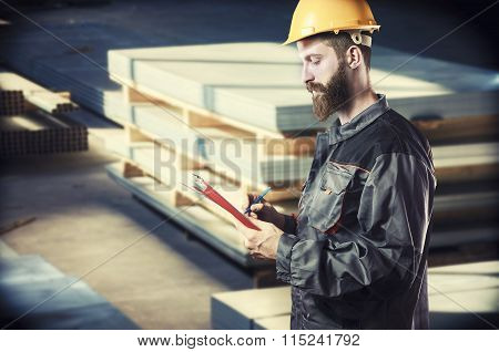 Worker In Protective Uniform And Protective Helmet