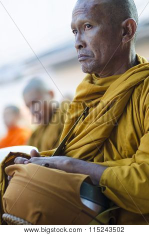 Monk At Alms Ceremony
