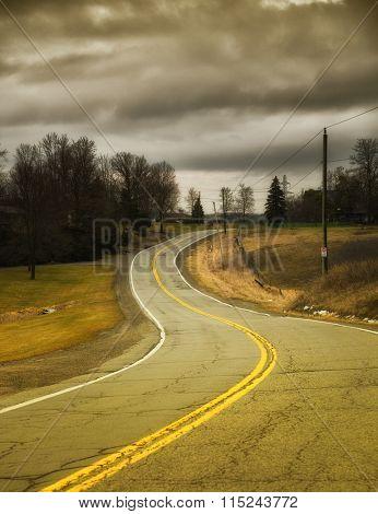 Countryside winding road during fall season