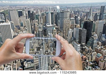 Taking Aerial Pictures By Smart Phone In Manhattan (nyc, Usa)