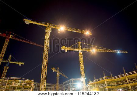cranes and illumination at night