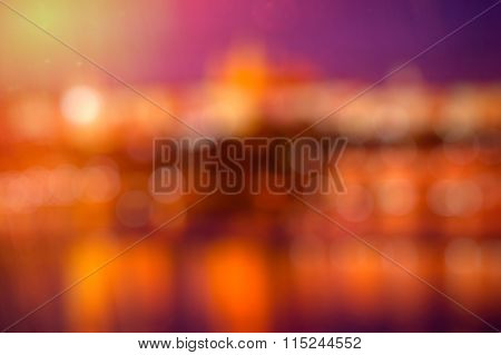 Abstract background in orange-red-purple with bokeh