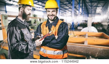 Smiling Workers With Protective Uniforms In Production Hall