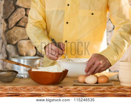 male chef in a yellow garment
