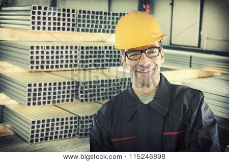 Smilng Worker In Protective Uniform And Protective Helmet