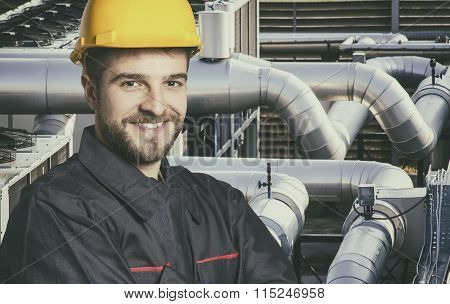 Smiling Worker In Protective Uniform And Protective Helmet