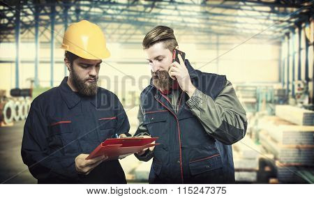 Workers In Protective Uniforms