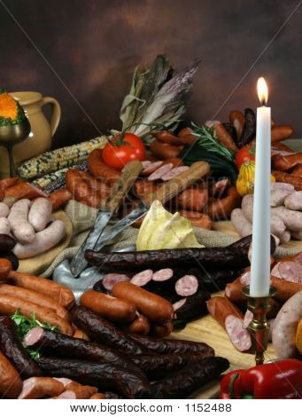 Group Of Meat On Holiday Table With Candle I Knife