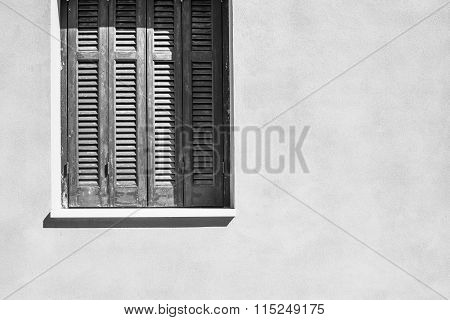 Part Window With A Shutters On House Facade