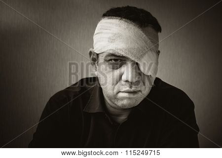 Wounded and cured man. Black and white portrait