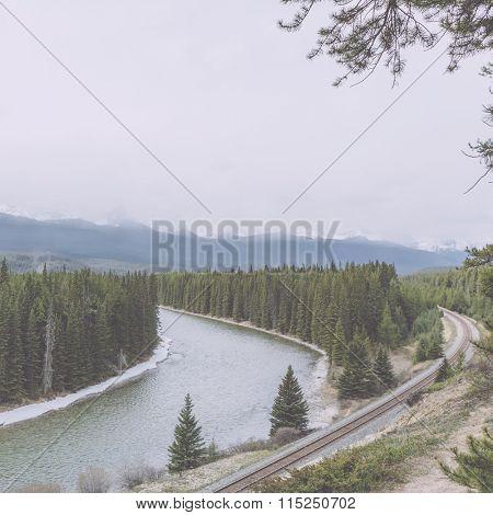 railway through banff national park, canada.