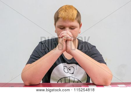 Young Teenager Pray With Folded Hands