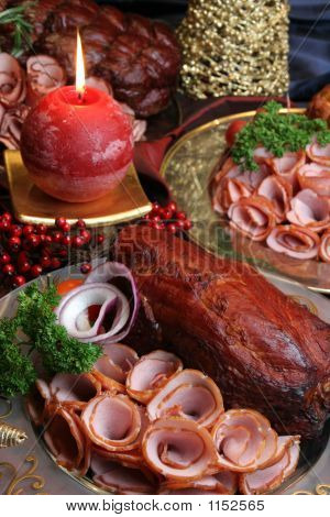Group Of Meat On Holiday Table With  Candle