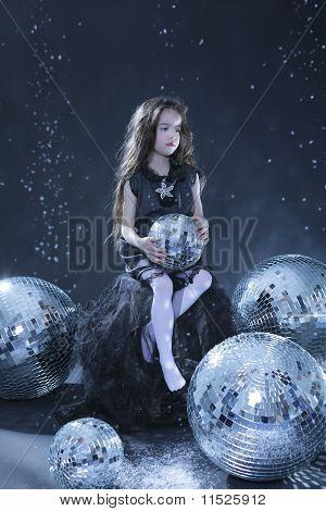 Beautiful girl with disco balls