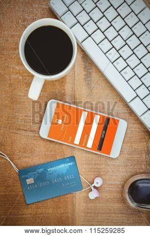 Digitally generated image of world credit card against coffee and white smartphone with headphones
