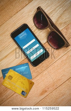 Credit Card against view of glasses and a smartphone