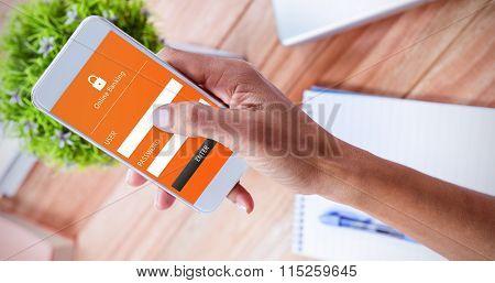 Online banking against overhead of feminine hand using smartphone