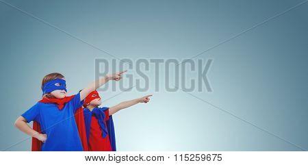Masked kids pretending to be superheroes against purple vignette