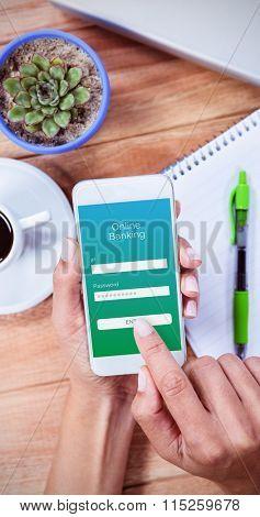 Online banking against overhead of feminine hands using smartphone